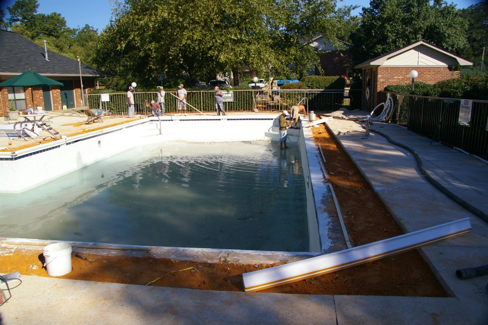 New pool deck being installed by Carolina Pool Plastering