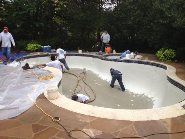 Carolina Pool Plastering  pool builders working on swimming pool tile