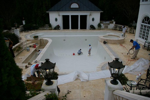 pool builders working on a pool upgrade in Charlotte, NC