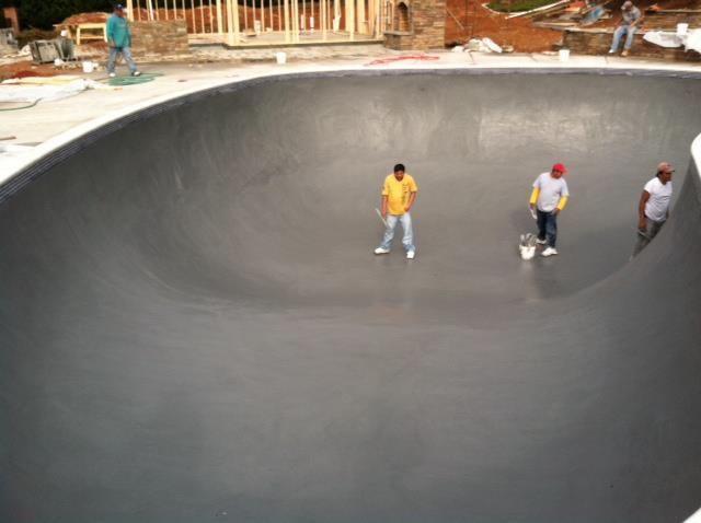 Pool builders working on a pool