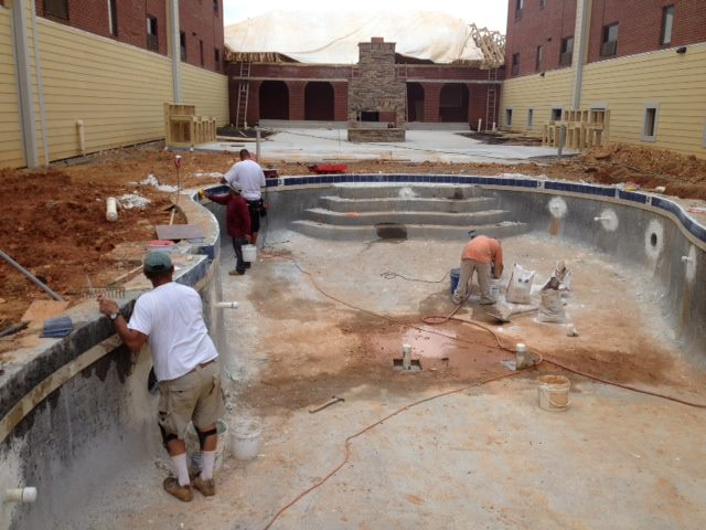 Reliable pool builders working on a pool