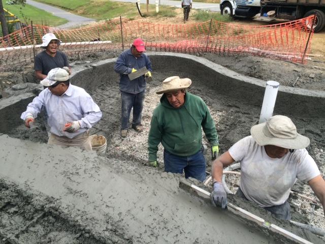 Pool builders working on new pool deck