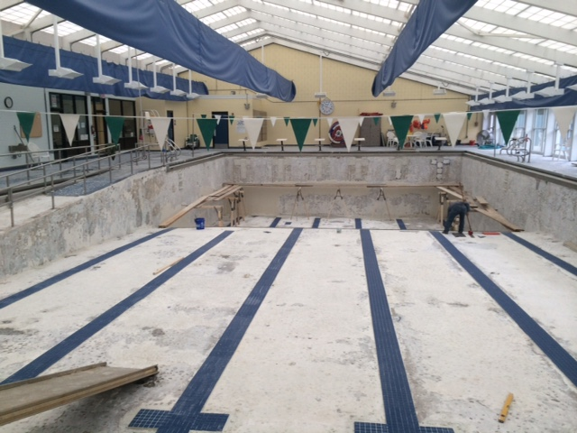 Pool contractors working on a pool