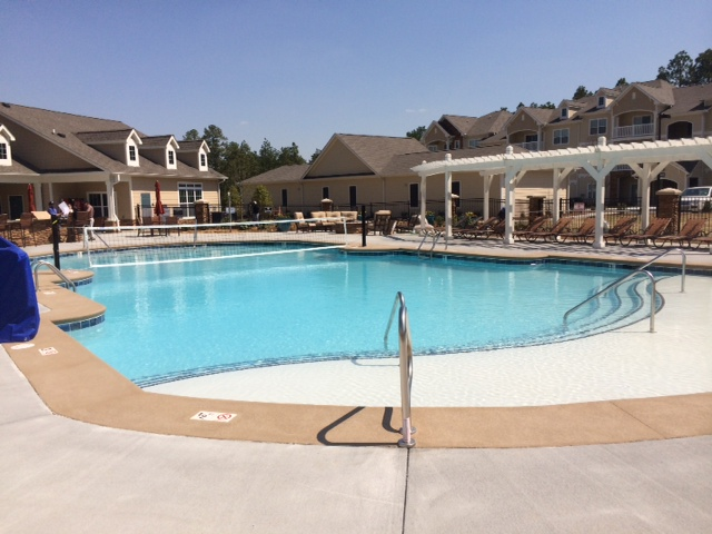 New pool deck installed by pool buiders