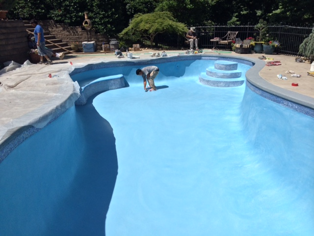 Most reliable pool contractors working on a swimming pool
