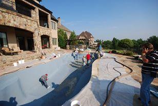 Pool contractors doing pool installation